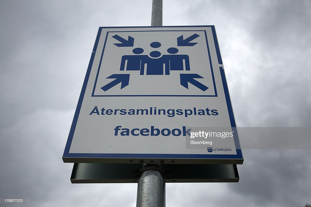 A sign indicates a meeting place for a fire alert outside Facebook Inc.'s new data storage center near the Arctic Circle in Lulea, Sweden, on Wednesday, June 12, 2013. The data center is Facebook's first outside the U.S., poised to handle all data processing from Europe, Middle East and Africa and the server hub is largest of its kind in Europe, and most northerly of its magnitude anywhere on earth. Photographer: Simon Dawson/Bloomberg via Getty Images