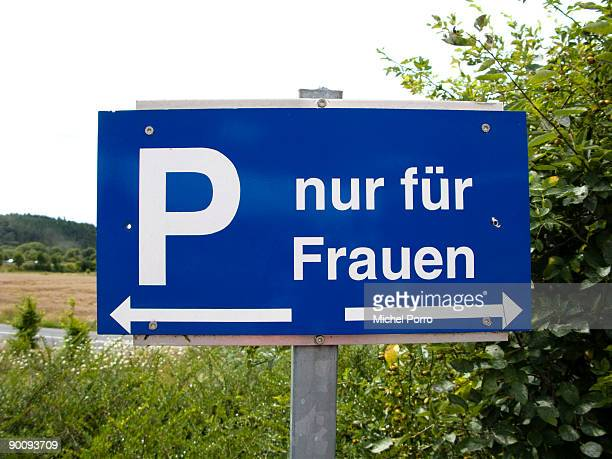 A sign indicates a parking spot intended for women only near the entrance of a highway gas station on July 30 2009 near Frankfurt Germany Especially...