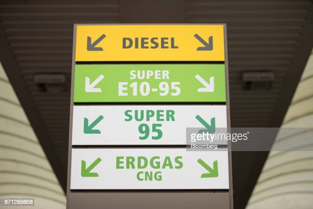 A sign indicates fuel pump locations including compressed natural gas on the forecourt of a petrol station during the Volkswagen AG CNG Mobility Day...