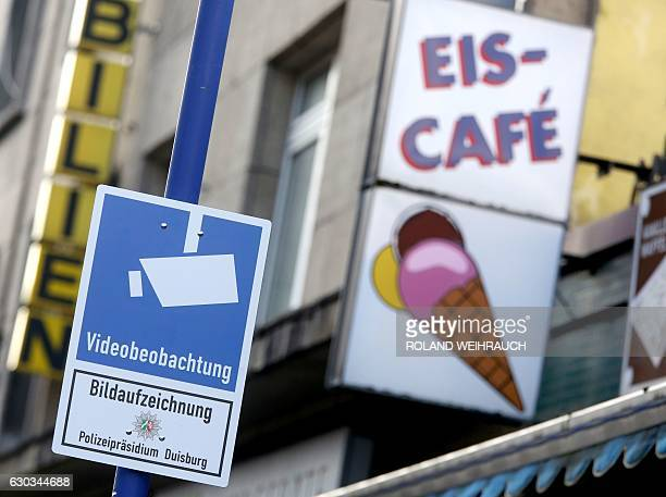 A sign indicates that police is executing video surveillance in a public area at the Marxloh district of Duisburg western Germany on December 21 2016...