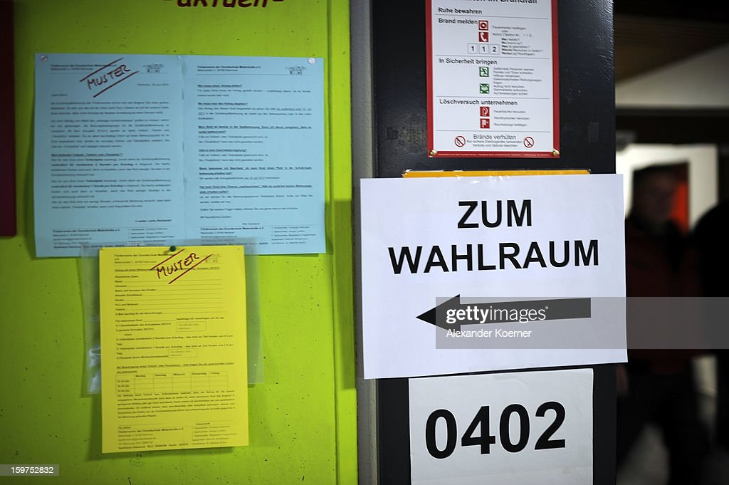 A sign indicates the direction as people arrive to cast their ballots at a polling station as the Lower Saxony eletions get underway on January 20, 2013 in Hanover, Germany. The elections are being seen by many as a strong indicator for the general elections scheduled for later this year.