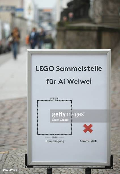 A sign indicates the location of a collection point for Lego donations for Chinese artist Ai Weiwei next to MartinGropiusBau museum on October 30...
