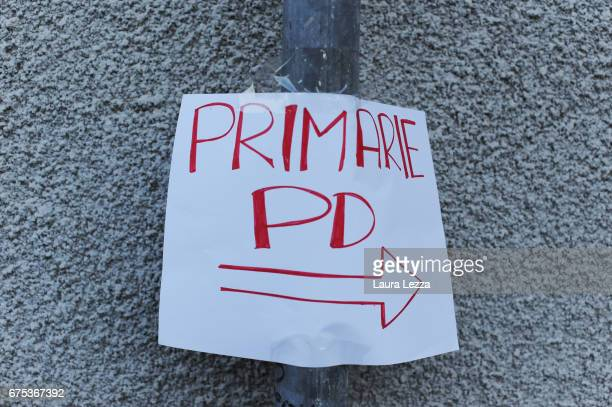 A sign indicating a small polling station of the PD is displayed after the vote for Democratic Party leadership primaries on April 30 2017 in Livorno...