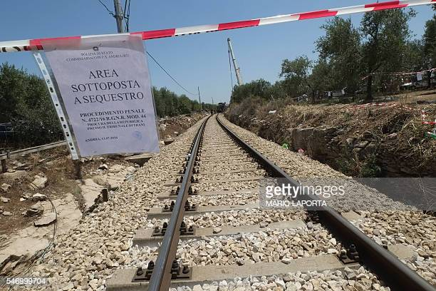 A sign indicating that the area is under judicial seizure is seen on the train crash site on July 13 2016 near Corato in the southern Italian region...