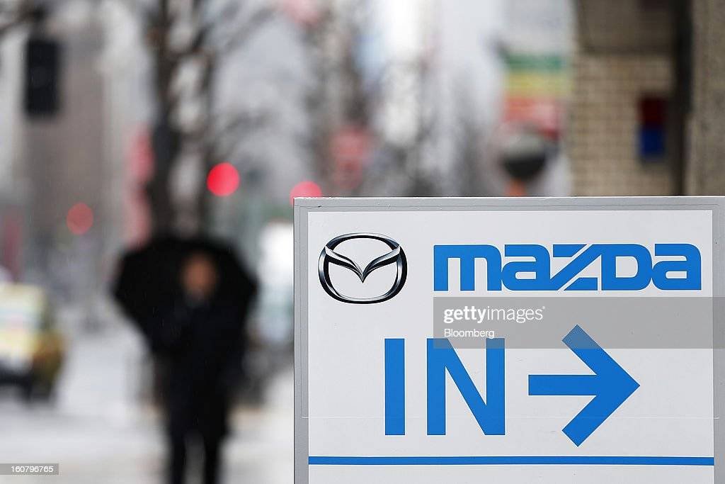 A sign indicating the entry direction stands outside a Mazda Motor Corp. showroom in Tokyo, Japan, on Wednesday, Feb. 6, 2013. Mazda, the best performer on the Nikkei 225 Stock Average in the past three months, more than doubled its full-year profit forecast on a weaker yen and demand for its fuel-efficient vehicles. Photographer: Kiyoshi Ota/Bloomberg via Getty Images
