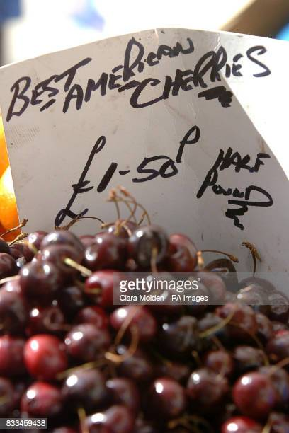 A sign indicating the price of cherries in imperial pounds and half pounds is seen on a fruit and vegetable stall at Strutton Ground market in...