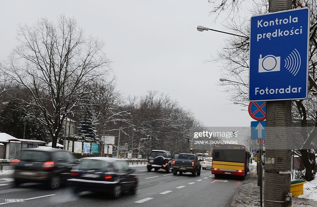 A sign informing about traffic radar control is pictured on the outskirts of the Polish capital Warsaw on January 17, 2013. With Poland's roads being the deadliest in the European Union, authorities are dramatically boosting the number of radars monitoring motorists. The move has drawn the ire of Poles, concerned they will have to pay more traffic fines.