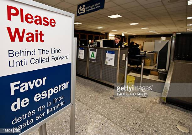 A sign informs international travelers what to do at the US Customs and Border Protection secondary inspection area of US Customs and Immigration at...