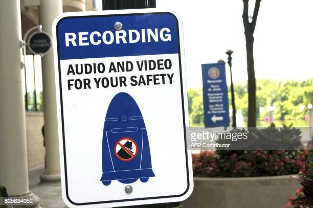 A sign informs the public about a fivefoot tall outdoor K5 security robot patroling the grounds of the Washington Harbour retailresidential center in...