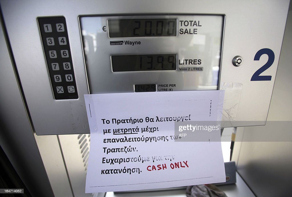 A sign is attached to a petrol pump that explains to clients that they can only pay by cash, in the capital Nicosia on March 27, 2013. The chief executive of the Bank of Cyprus, the island's biggest lender, has been sacked by the central bank governor as part of an international bailout deal, state media said.