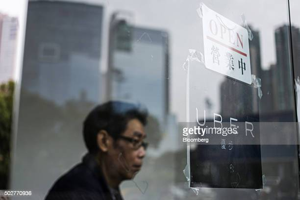 A sign is displayed at an Uber Technologies Inc office during a driver recruitment event in Hong Kong China on Tuesday Dec 29 2015 Uber is in the...