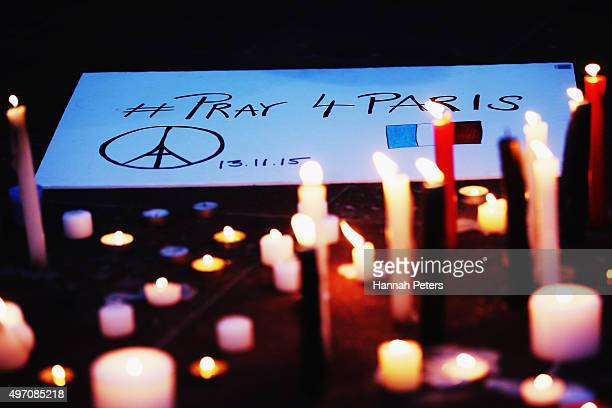 A sign is displayed during a vigil in Aotea Square to remember victims of the Paris attacks on November 14 2015 in Auckland New Zealand According to...