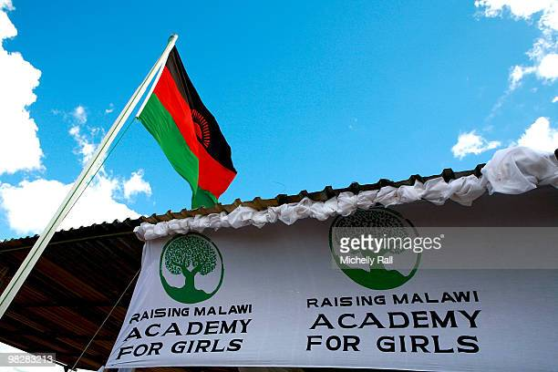 A sign is displayed for the Raising Malawi Academy for Girls on April 6 2010 in Lilongwe Malawi Madonna visited the academy where a brief ceremony...