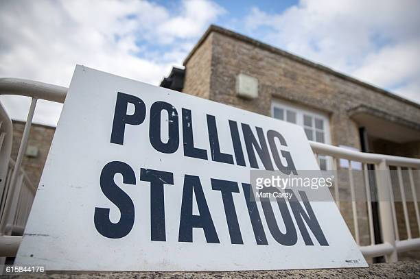 A sign is displayed in front of a polling station in the village of Spelsbury as voters go to the polls in a byelection in the constituency of Witney...