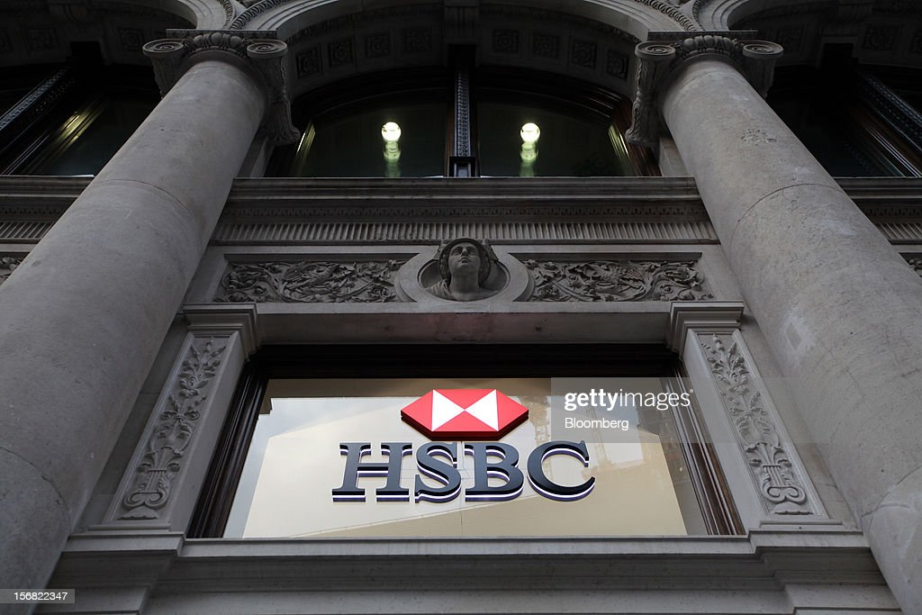 A sign is displayed on a window outside a HSBC Holdings Plc bank branch in London, U.K., on Thursday, Nov. 22, 2012. Shares of HSBC have climbed 26 percent this year in London trading, and 30 percent in Hong Kong, as Chief Executive Officer Stuart Gulliver pared costs and sold assets to revive profit and focus on emerging economies in which the bank has a greater market share. Photographer: Chris Ratcliffe/Bloomberg via Getty Images