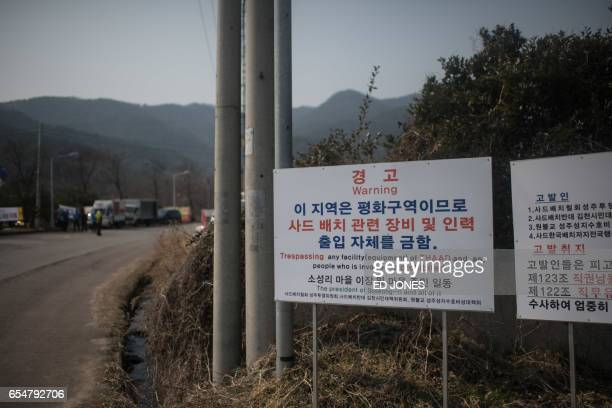 A sign is displayed outside a golf course being used as the site for the recently installed US Terminal High Altitude Area Defense system in Seongju...