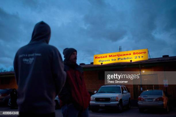 A sign is displayed outside the 3D Denver Discrete Dispensary on January 1 2014 in Denver Colorado Legalization of recreational marijuana sales in...