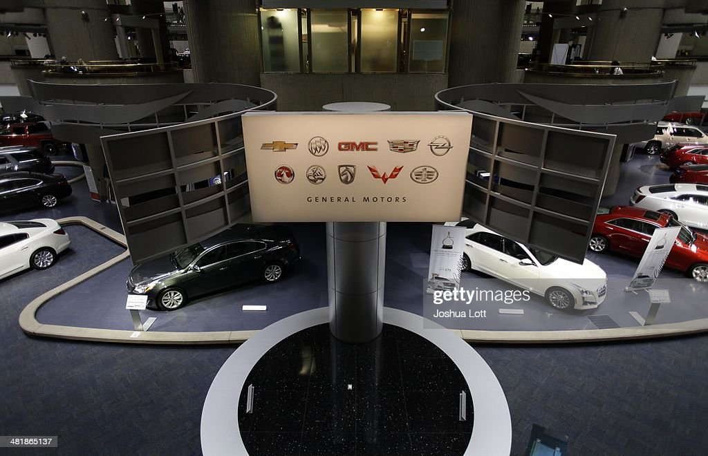 A sign is displayed with General Motors vehicles at their headquarters April 1 2014 in Detroit Michigan General Motors has recalled millions of...
