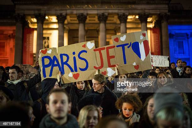 A sign is held as people hold a vigil for victims of the Paris terrorist attacks in Trafalgar Square on November 14 2015 in London England Several...
