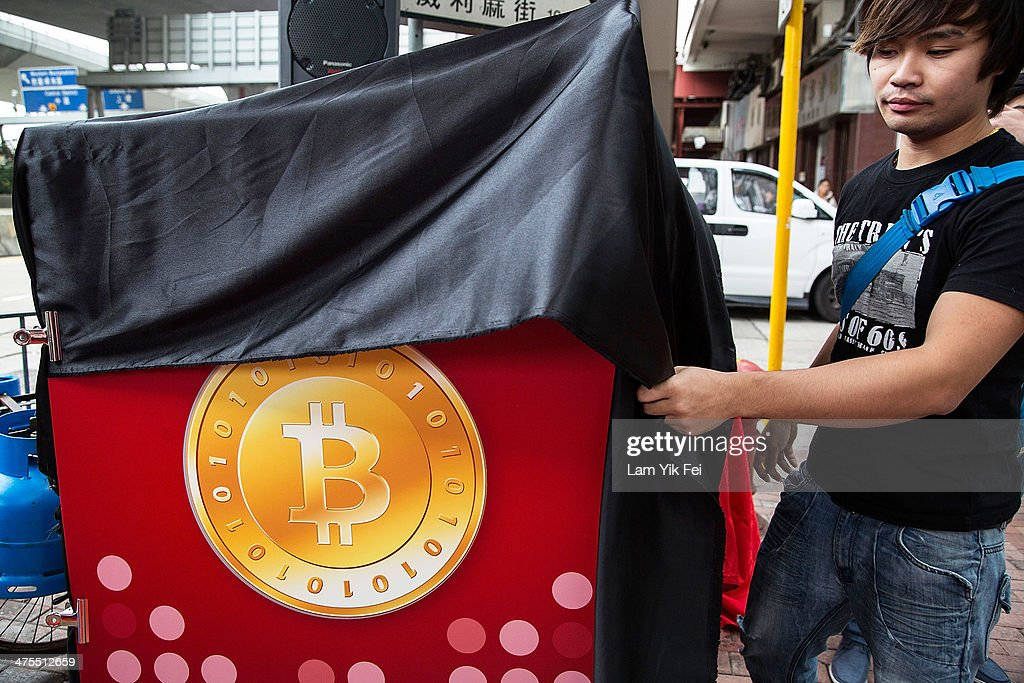 A sign is installed at first bitcoin retail store open in Hong Kong on February 28, 2014 in Hong Kong. Asia Nexgen, a Hong Kong based bitcoin exchange has launched a physical store enabling customers to purchase bitcoin and store it in their digital bitcoin wallets. Bitcoin Group HK and Hong Kong Bitcoin ATM plan to launch bitcoin 'ATM's machines in the area. in 2008 Bitcoin was launched as an alternative currency, with the commodity boasting the ability to be transferred without the need of the traditional monetary banking system.