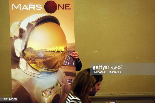 A sign is moved prior to the start of a Mars One press conference to announce the launch of astronaut selection for a Mars space mission project in...