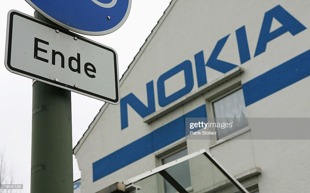 A sign is pictured in front of a wall, painted with the logo of Finland's mobile phone manufacturer Nokia on January 18, 2008 in Bochum, Germany. A confederation of German unions warned that the decision by Nokia to close its plant in Bochum threatened the region's economic future.