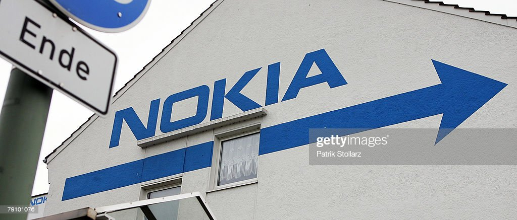 A sign is pictured in front of a wall which is painted with the logo of Finland's mobile phone manufacturer Nokia on January 18, 2008 in Bochum, Germany. A confederation of German unions warned that the decision by Nokia to close its plant in Bochum threatened the region's economic future.