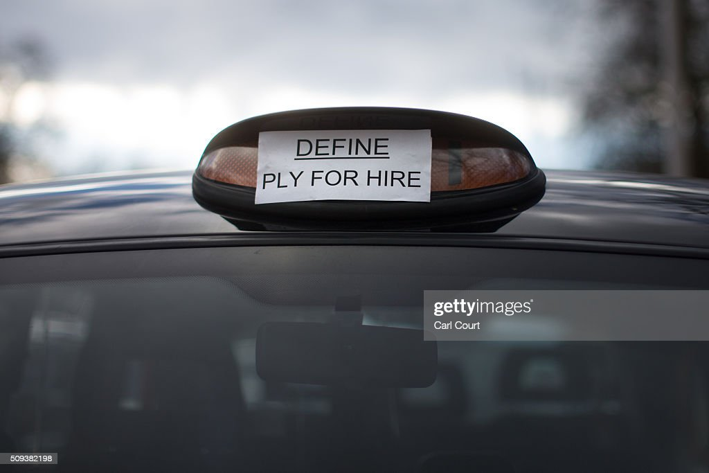 A sign is placed over the light of a black cab as the driver takes part in a strike to protest against Uber on February 10, 2016 in London, England. Drivers are claiming that Uber is not subjected to the same stringent regulation requirements as they are and that deregulation of the trade has compromised passenger safety.