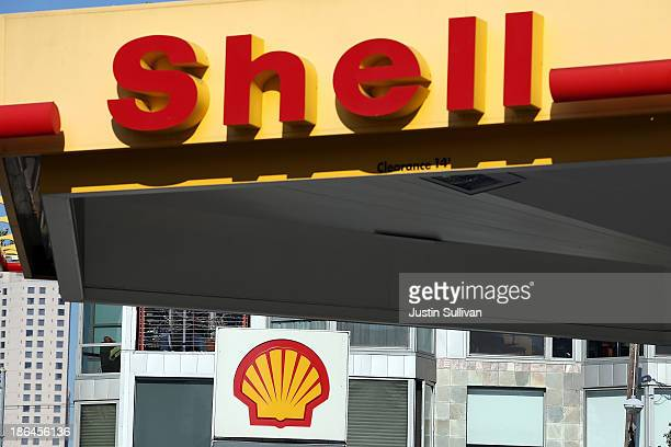 A sign is posted at a Shell gas station on October 31 2013 in San Francisco California Royal Dutch Shell reported a 32% decline in third quarter...
