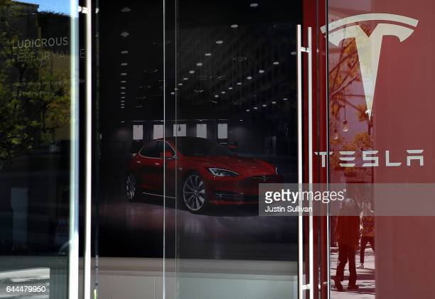 A sign is posted at a Tesla showroom on February 23 2017 in Santa Monica California Tesla shares dropped over 5 percent on Thursday after a mixed...