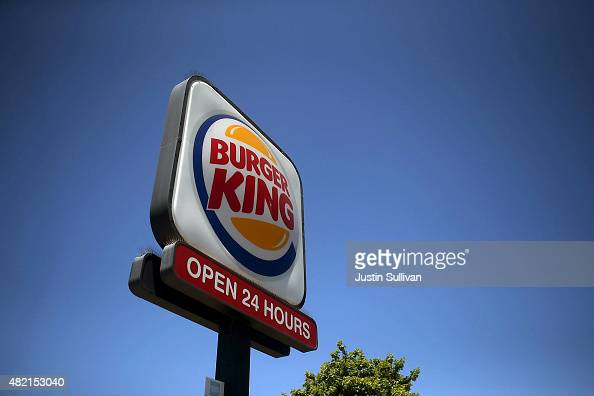 A sign is posted in front of a Burger King restaurant on July 27 2015 in San Rafael California Burger King parent company Restaurant Brands...