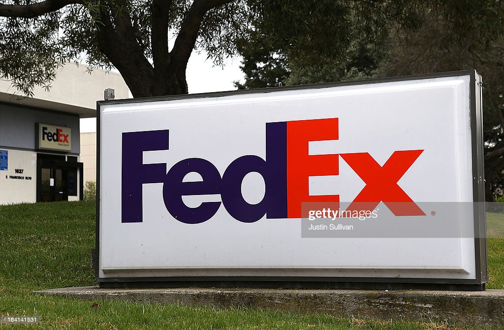 A sign is posted in front of a distribution center on March 20, 2013 in San Rafael, California. FedEx Corp. is lowering its 2013 forecast after posting weak third quarter earnings with net income of $391.1 million or $1.23 a share compared to $427.5 million or $1.55 a share, one year ago.