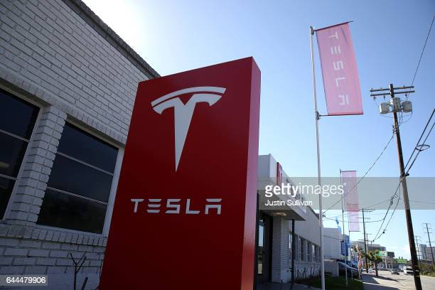 A sign is posted in front of a Tesla service center on February 23 2017 in Los Angeles California Tesla shares dropped over 5 percent on Thursday...