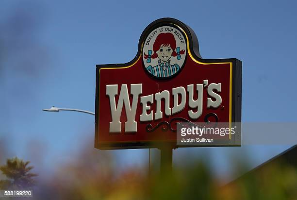 A sign is posted in front of a Wendy's restaurant on August 10 2016 in Daly City California Wendy's reported a 22% decline in second quarter earnings...