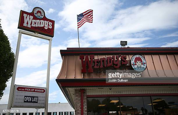 A sign is posted in front of a Wendy's restaurant on May 7 2015 in Richmond California Wendy's announced plans to sell 640 of its company owned...