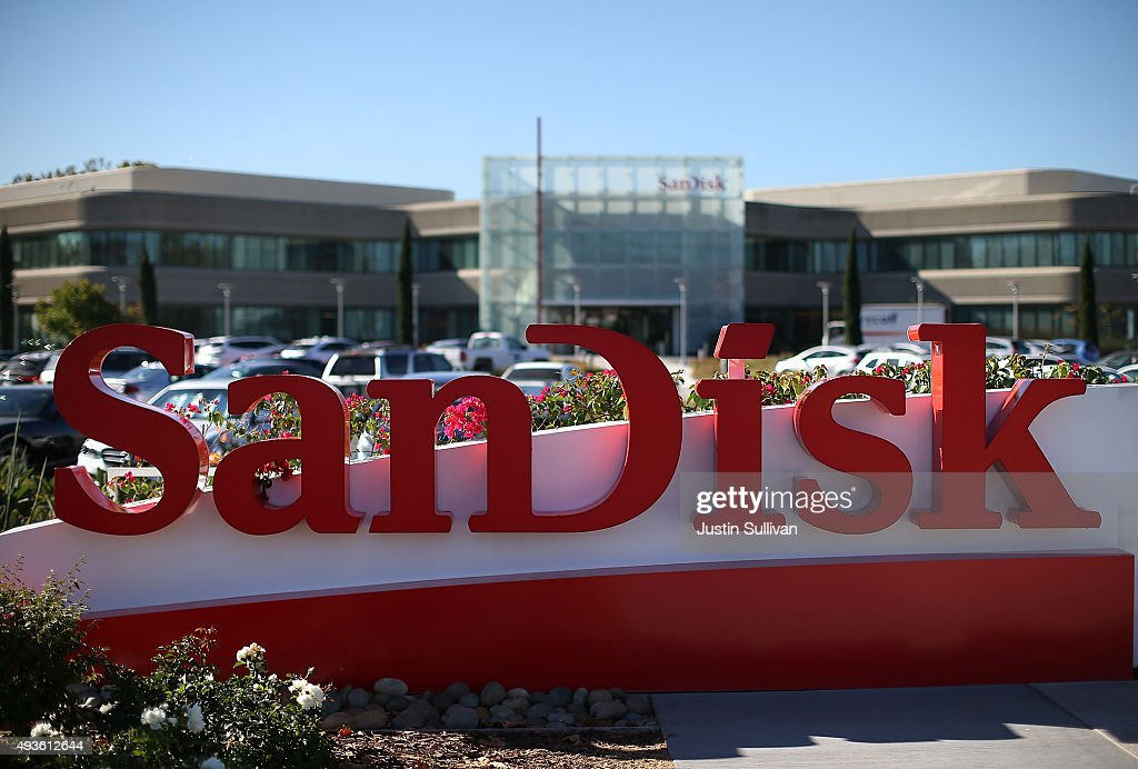 A sign is posted in front of the SanDisk headquarters on October 21, 2015 in Milpitas, California. Computer data storage company Western Digital announced plans to acquire flash memory storage maker SanDisk for $19 billion.