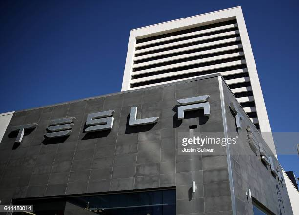A sign is posted in on the exterior of a Tesla service center on February 23 2017 in Los Angeles California Tesla shares dropped over 5 percent on...