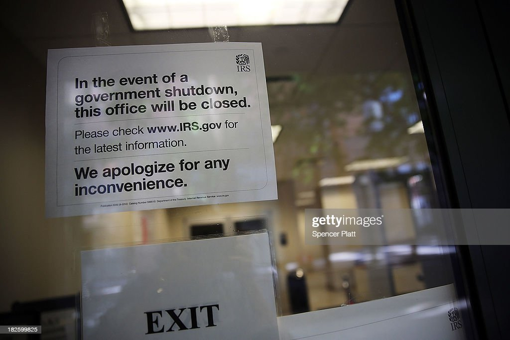 A sign is posted in the window of an IRS office in Brooklyn notifying that the office is closed due to the government shutdown on October 1, 2013 in New York City. Federal museums and parks across the nation are closed starting today due to a government shutdown for the first time in nearly two decades. The Dow Jones industrial average, the S&P 500 and the Nasdaq all rose slightly higher in early trading Tuesday morning.