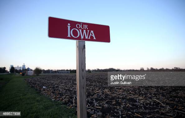 A sign is posted next to an empty corn field on April 12 2015 in Dallas Center Iowa Iowa is the first state in the nation to hold an electoral event...