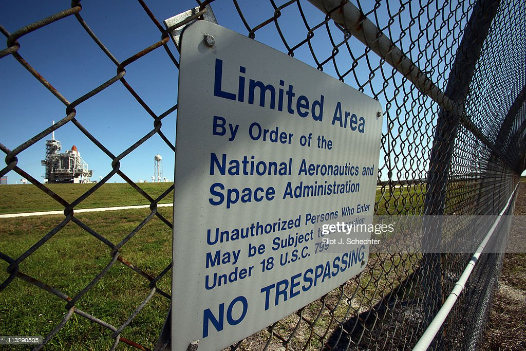 A sign is posted on a fence as NASA space shuttle Endeavour STS-134 sits on launch pad 39A at the Kennedy Space Center April 30, 2011 in Cape Canaveral, Florida. Repair efforts are underway for a thermostat malfunction which caused a scrub of yesterdays launch attempt. This will be Endeavour's final trip to the International Space Station.