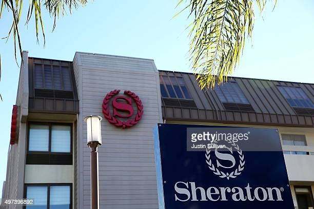 A sign is posted on the exterior of a Sheraton hotel on November 16 2015 in San Francisco California Marriott International announced plans to...