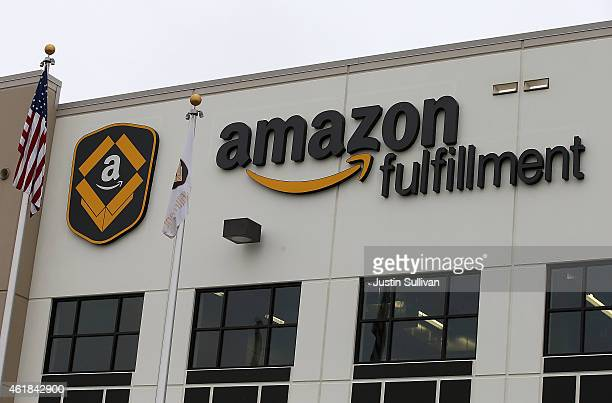 A sign is posted on the exterior of an Amazon fulfillment center on January 20 2015 in Tracy California Amazon officially opened its new 12 million...