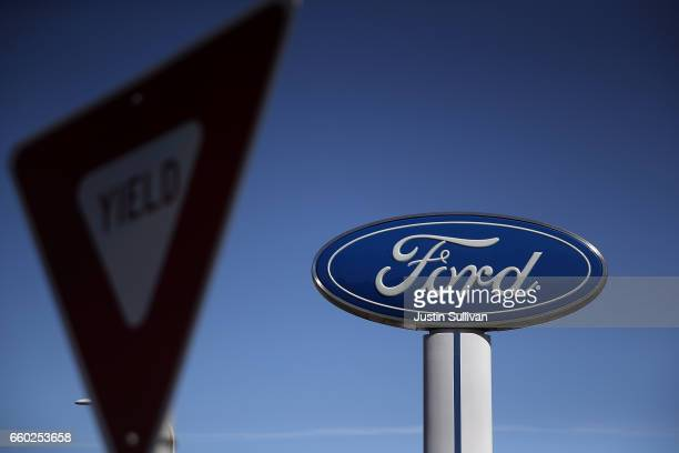 A sign is posted outside of a Ford dealership on March 29 2017 in Colma California Ford announced that it is recalling more than 441000 vehicles in...