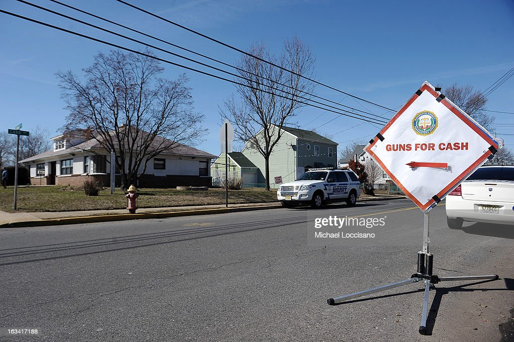 A sign is posted promoting a gun buyback program on March 9, 2013 in Keansburg, New Jersey. In a national effort to curb gun violence, the NJ Attorney General's Office in cooperation with the Monmouth County Prosecutor's Office held an anonymous buyback program where every gun turned in is to be melted down.