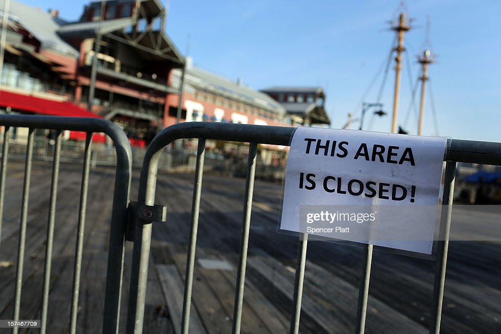 A sign is posted that reads 'THIS AREA IS CLOSED!' on the flood damaged pier affected by Superstorm Sandy at South Street Seaport is closed and empty of tourists on December 3, 2012 in New York City. South Street Seaport, an area popular with tourists which was about to go through a major redevelopment, suffered severe damage from Hurricane Sandy. Most of the buildings and businesses, including the South Street Seaport Museum, suffered severe flooding and remained closed. According to a new Siena Research Institute poll, most New Yorkers overwhelmingly agree that climate change was behind Hurricane Sandy.