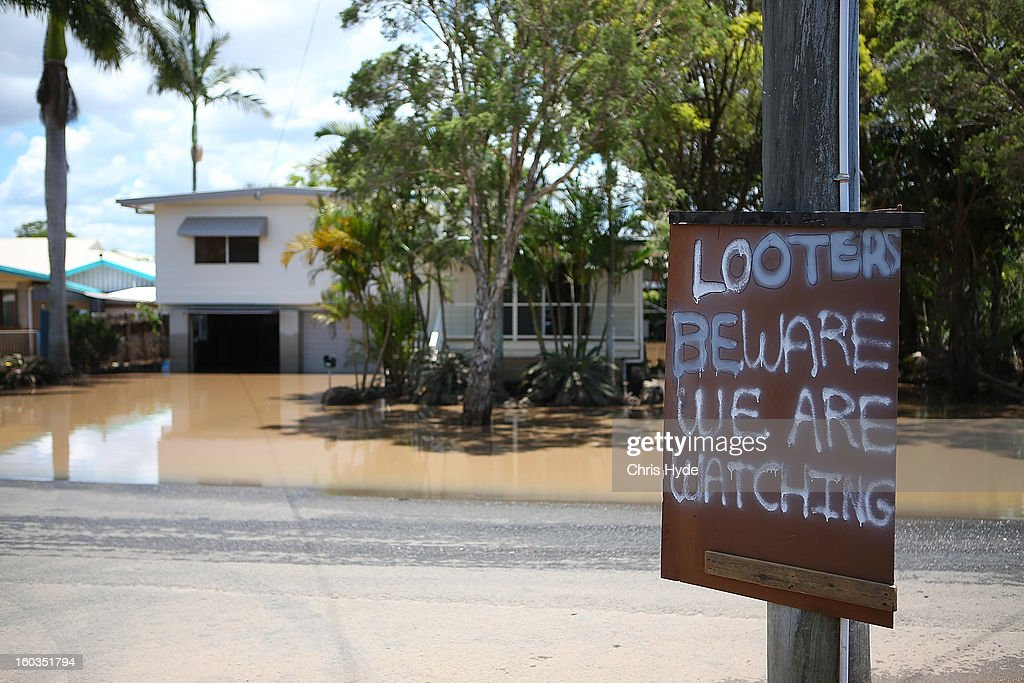 A sign is put up in East Bundaberg after reports of looters as parts of southern Queensland experiences record flooding in the wake of Tropical Cyclone Oswald on January 30, 2013 in Bundaberg, Australia. Flood waters peaked at 9.53 metres in Bundaberg yesterday and began receding overnight, as residents and relief teams prepare to clean-up debris. Four deaths have been confirmed in the Queensland floods and the search is on for two men though to be missing in floodaters in Gatton.