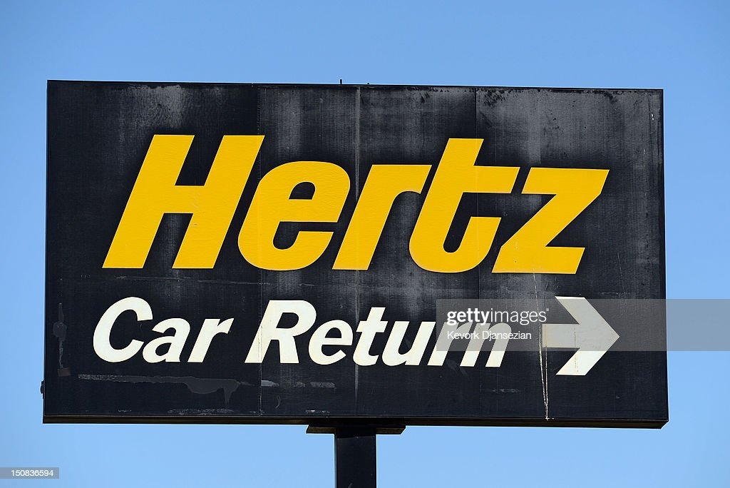 A sign is seen at a Hertz Global Holdings car rental branch August 27, 2012 in Los Angeles, California. Two major rental car companies agreed to merge as Hertz Global Holdings announced it is acquring Dollar Thrifty Automotive Group for $2.3 billion.