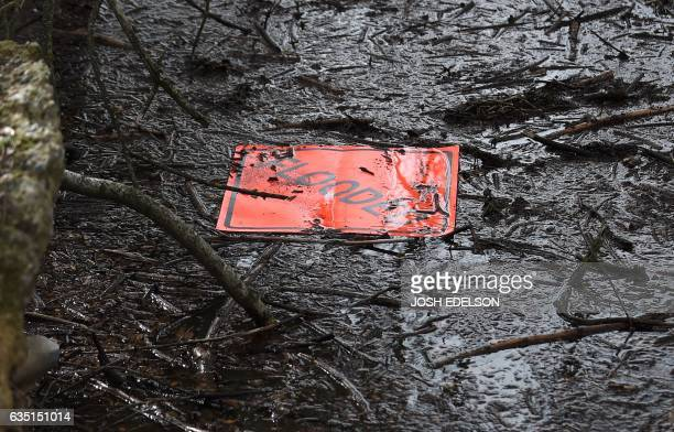 A sign is seen floating in a marsh at the flooded Riverbend Park as the Oroville Dam releases water down the spillway in Oroville California on...