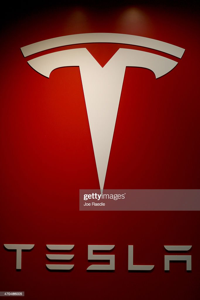 A sign is seen in theTesla Motors vehicle showroom at the Dadeland Mall on February 19, 2014 in Miami, Florida. Tesla said today it earned $46 million in the fourth quarter on a non-adjusted basis, or 33 cents a share, causing shares in the company to jump 12 percent.