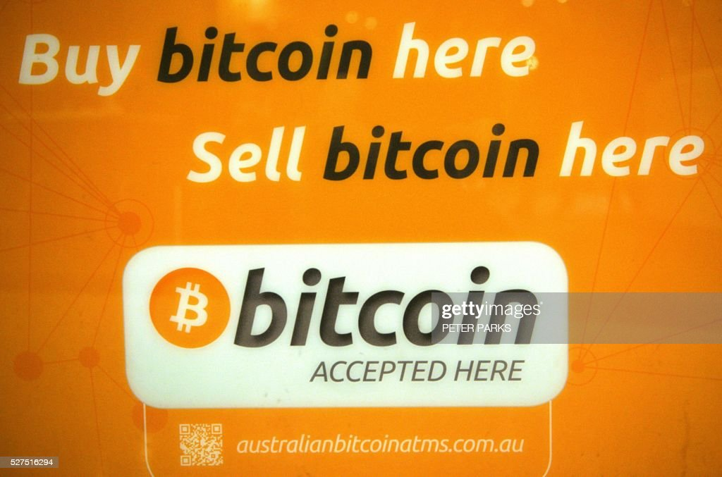 A sign is seen on a Bitcoin machine in Sydney on May 3, 2016. Secretive Australian entrepreneur Craig Wright, who has revealed himself as the creator of the virtual Bitcoin currency, is an elusive individual who appears to have covered his tracks well. / AFP / Peter PARKS
